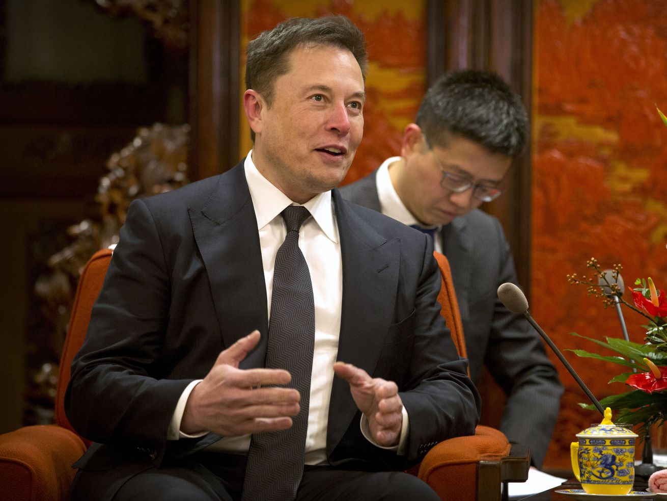 South African immigrant Elon Musk speaks in China, where a significant portion of H-1B applications originate.