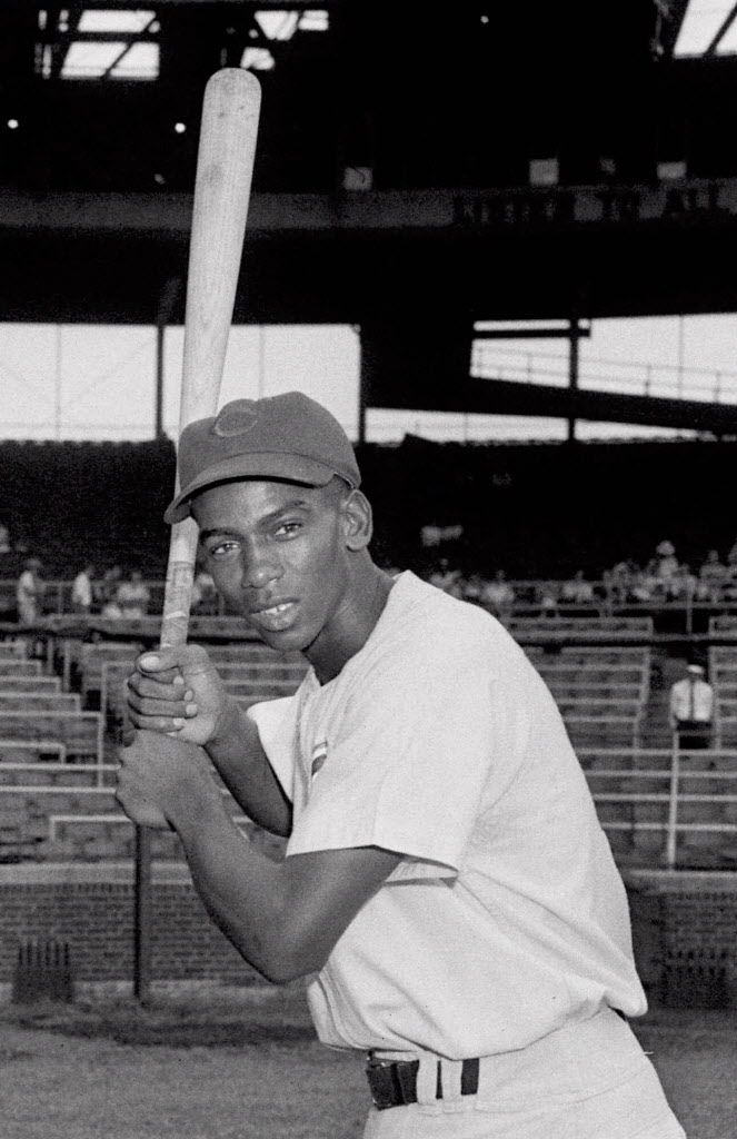 Banks poses July 5, 1955 at Wrigley Field in Chicago, Illinois. As if pennant races and wild card chases aren't tough enough, now baseball wants fans to separate Cochrane from Bench, Cobb from Mays, Ruth from Aaron.(AP Photo)