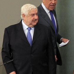 """Russian Foreign Minister Sergey Lavrov, right, and Syrian Foreign Minister Walid Moallem attend a news conference in Moscow, Tuesday, April 10, 2012. Russia has called on the opposition as well as countries that """"influence them"""" to use their powers to bring about a cease-fire in Syria."""