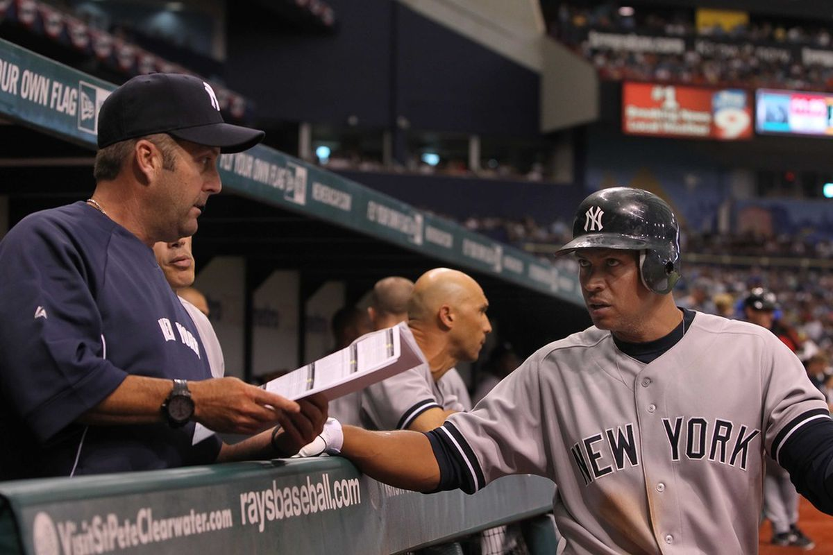 """""""Do you see that wall in the outfield? Try hitting it over that!"""" -Kevin Long, Yankees hitting coach, instructs Alex Rodriguez on what to do when at bat.    Mandatory Credit: Kim Klement-US PRESSWIRE"""