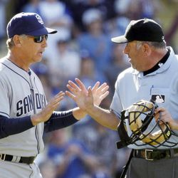 San Diego Padres manager Bud Black, left, argues with plate umpire Dale Scott after the Los Angeles Dodgers turned a triple play in the ninth inning of a baseball game in Los Angeles Sunday, April 15, 2012. Scott ejected Black from the game. The Dodgers won 5-4.