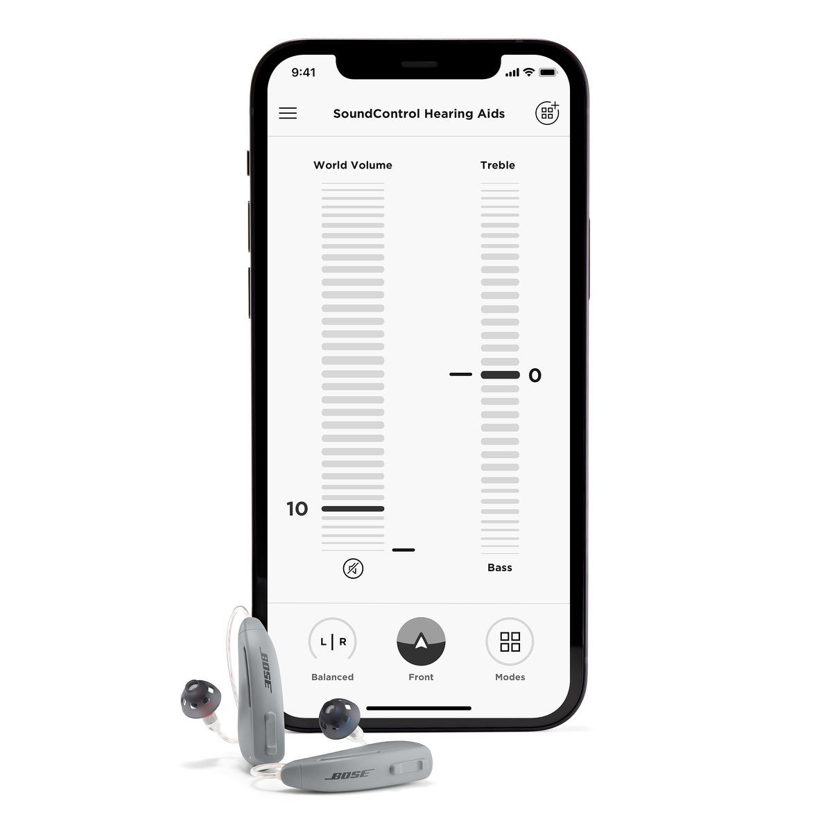 A smartphone propped next to the Bose hearing aids. On the phone's screen is a page that shows scrolling sliders for adjusting World Volume on the left and Treble and Bass on the right.