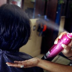 Hair spray is used on a client at Bladework Hair Studio in Salt Lake City on Friday, March 29, 2013.  Products such as hair spray, carpet cleaners and air fresheners contribute to Utah's PM2.5 problem.
