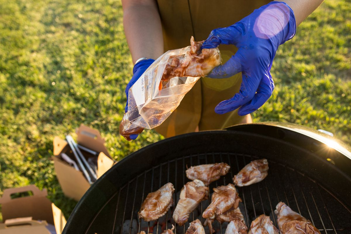 Marinated chicken wings being barbecued on a grill