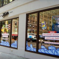 The windows wrap around 64th Street.