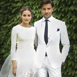Designer Carolina Herrera made a three-piece ensemble for Olivia Palermo's June 24th, 2014 wedding to Johannes Huebl: a cashmere sweater, tulle skirt, and shorts underneath.