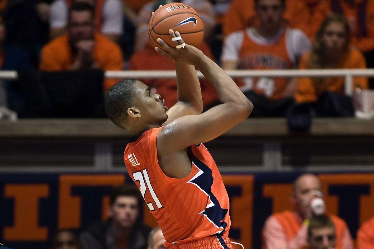 Malcolm Hill shoots in a game against Michigan at the State Farm Center.