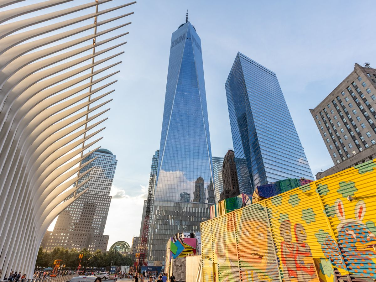 The World Trade Center in New York City. There are several tall buildings with glass facades.