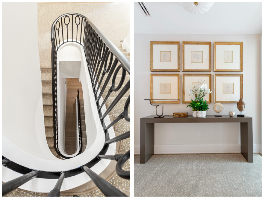 A winding stairwell and foyer with art on the walls in a large townhome.