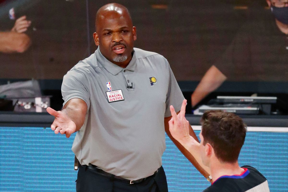 Head coach Nate McMillan of the Indiana Pacers reacts to a call against the Miami Heat as referee Ben Taylor signals the foul during the first half of Game 3 of an NBA basketball first-round playoff series at AdventHealth Arena on August 22, 2020 in Lake Buena Vista, Florida.