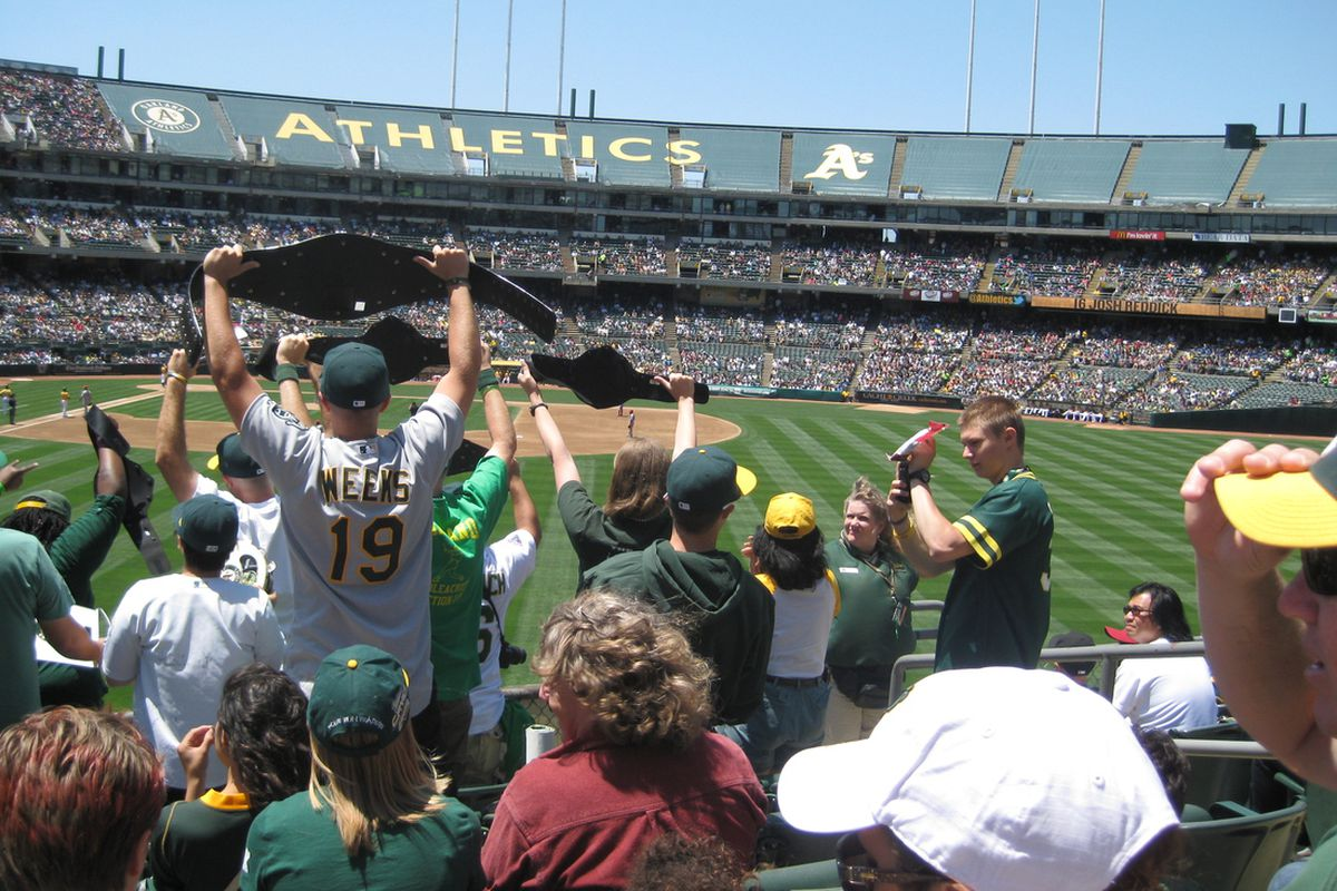 Fans in Section 149 hold up their wrestling belts as Josh Reddick steps up to the plate.