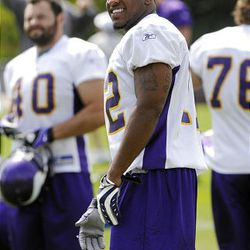 Vikings receiver Percy Harvin, a first-round pick, smiles while participating in his first NFL practice on Sunday.