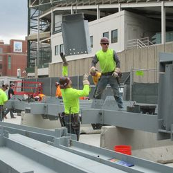 3:00 p.m. Piece being lowered into place on Sheffield -