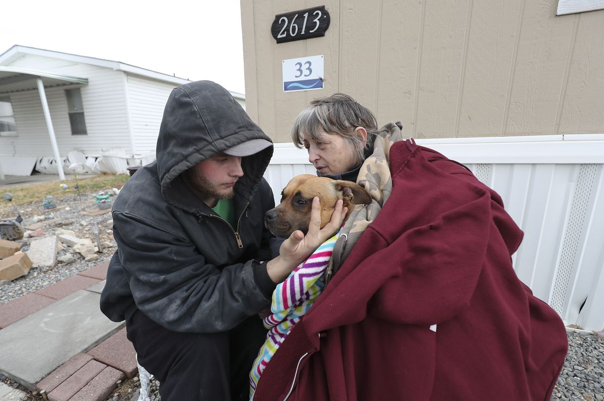 Candy Whisler hugs her scared dog Athena and grandson Paris Whisler after a 5.7 magnitude earthquake centered in Magna hit on Wednesday, March 18, 2020.