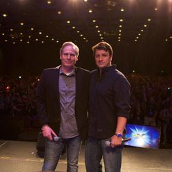 Salt Lake Comic Con co-founder Dan Farr and Nathan Fillion on stage Saturday during the FanX convention.
