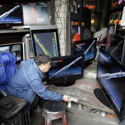 A man watches a TV news showing the computer-generated rocket of North Korea at a home appliance retailer in Seoul, South Korea, Friday, April 13, 2012.  North Korea's much-anticipated rocket launch ended quickly in failure early Friday, splintering into pieces over the Yellow Sea soon after takeoff.