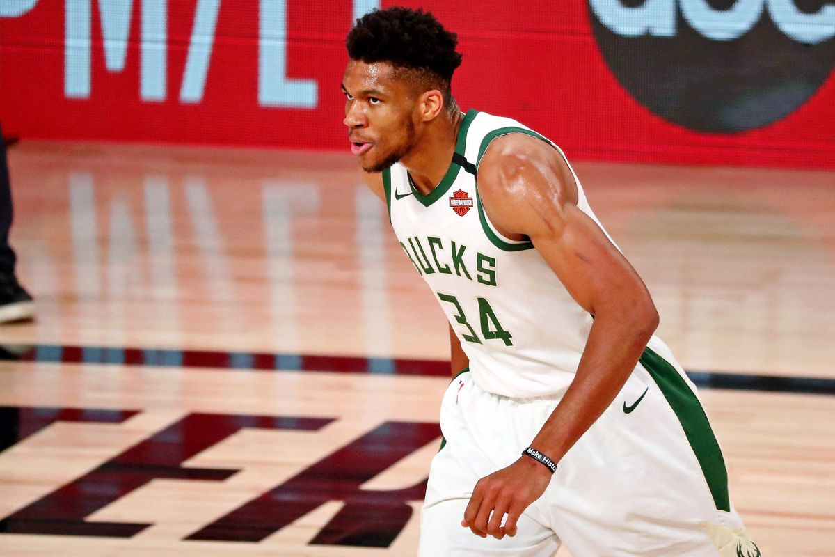 Milwaukee Bucks forward Giannis Antetokounmpo reacts after a play against the Miami Heat during the first half of game four of the second round of the 2020 NBA Playoffs at ESPN Wide World of Sports Complex.