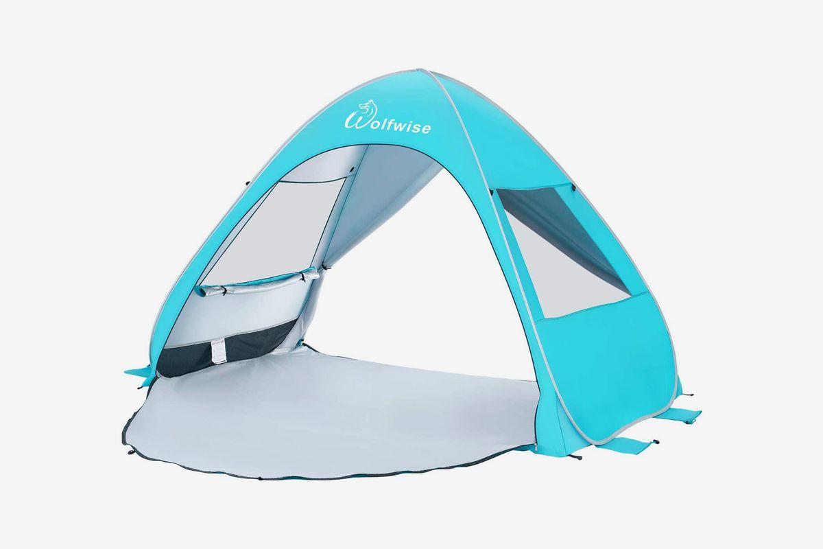 A bright blue pop up beach tent