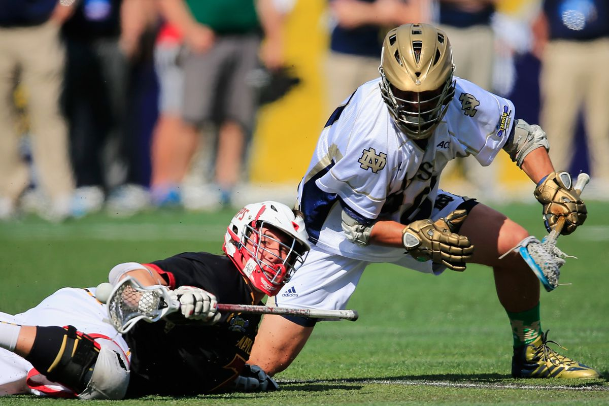 Maryland's Charlie Raffa and ND's Nick Ossello tangle on the turf.