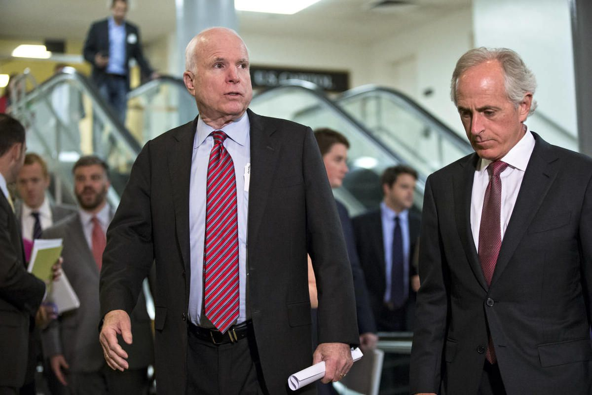 Sen. John McCain, R-Ariz., left, and Sen. Bob Corker, R-Tenn., right, members of the Senate Foreign Relations Committee, walk to a closed-door briefing on Syria with Secretary of State John Kerry, at the Capitol in Washington, Tuesday, Sept. 17, 2013.