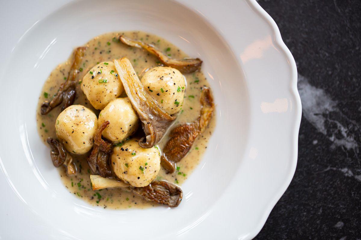 Ricotta gnudi with maitake mushrooms and Beurre Monte black truffle