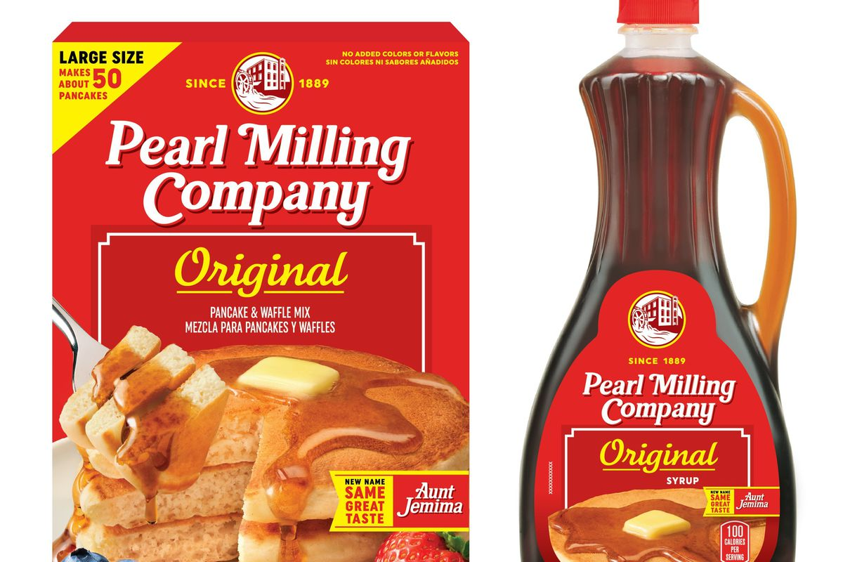 A red and yellow box of Pearl Milling Company pancake mix next to a plastic bottle of syrup with the same branding.