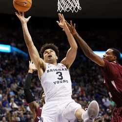 Brigham Young Cougars guard Elijah Bryant (3) splits Texas Southern Tigers guard Donte Clark (1) and Texas Southern Tigers center Trayvon Reed (5) for a shot as BYU and Texas Southern play an NCAA basketball game in Provo at the Marriott Center on Saturday, Dec. 23, 2017. BYU won 73-52.