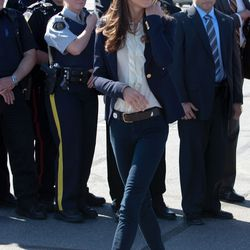 Wearing a Linda Camm belt, By Malene Birger shirt, Smythe navy blazer, and J Brand jeans on July 6th, 2011 for day six of her Canadian tour with Price William.