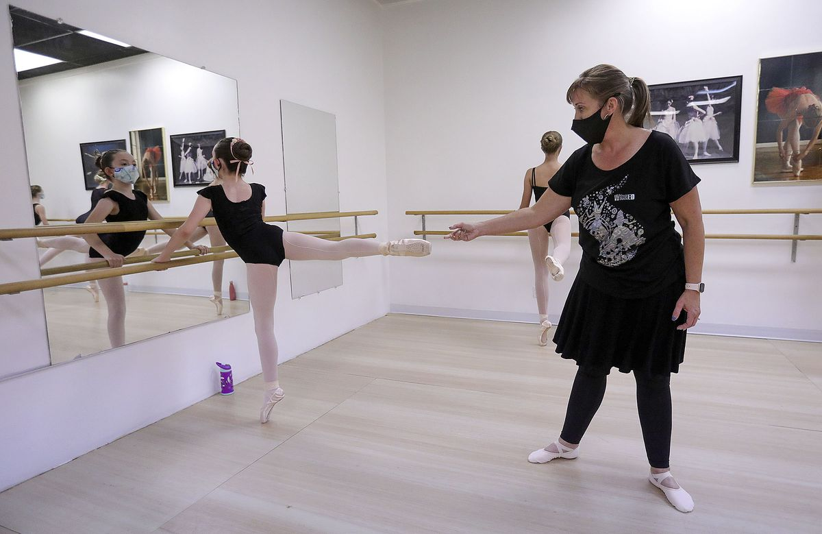 Megan Ware guides Sadeelynn Savage's foot up as she teaches ballet at Bountiful School of Ballet, which Ware co-owns, in Woods Cross on Thursday, Sept. 17, 2020.