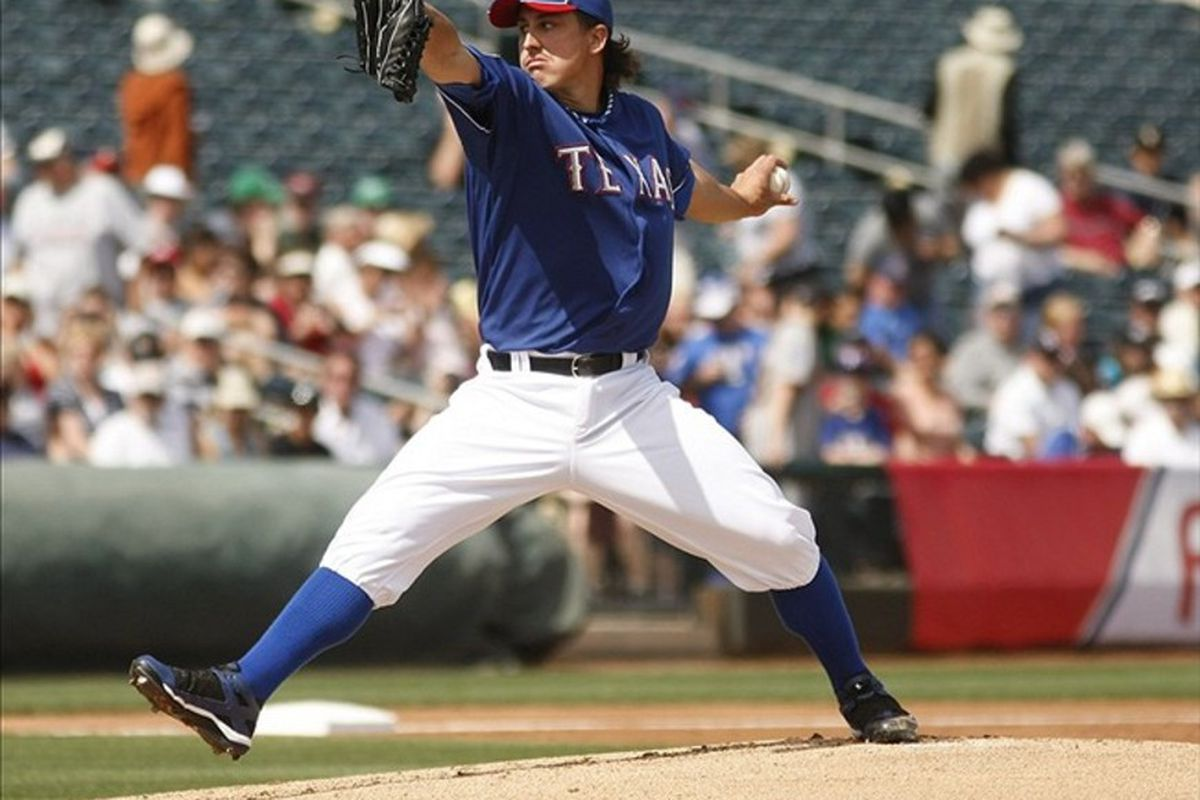 March 11, 2012; Surprise, AZ, USA; Texas Rangers starting pitcher Derek Holland (45) throws against the Cleveland Indians in the first inning at Surprise Stadium.  Mandatory Credit: Rick Scuteri-US PRESSWIRE