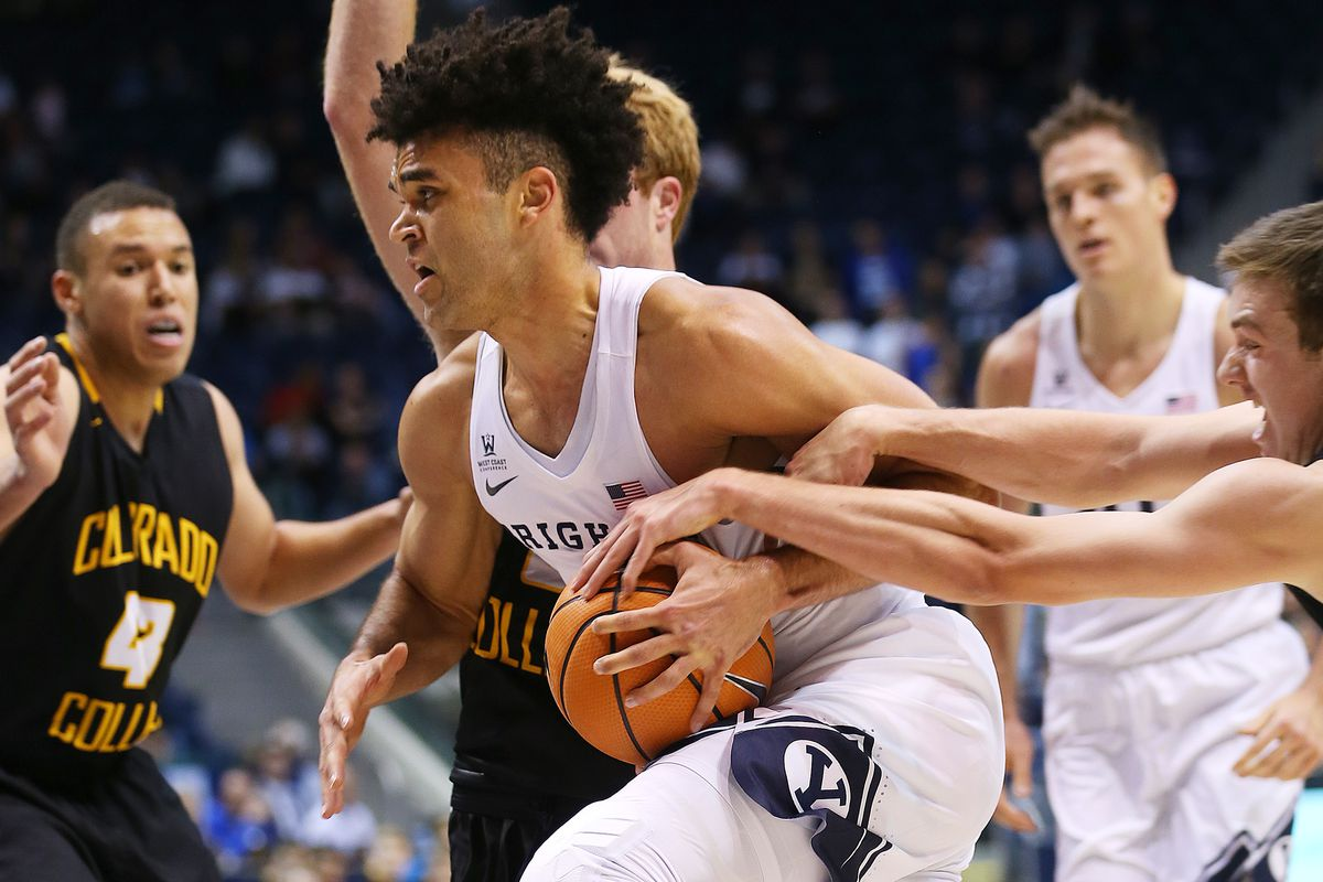 Colrado College's Ryan Young grabs onto BYU guard Elijah Bryant (3) as he drives to the basket as BYU and Colorado College play at the Marriott Center in Provo on Wednesday, Nov. 8, 2017.