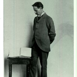 George Schweich, a grandson of early LDS Church member David Whitmer, stands next to the printer's manuscript of the Book of Mormon. Schweich inherited the manuscript from his grandfather and sold the manuscript in 1903 to the Reorganized Church of Jesus Christ of Latter Day Saints (later renamed Community of Christ), where it has remained to this day.