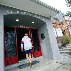 Quinn Stagg, president of Pi Kappa Alpha at the University of Utah in Salt Lake City, walks into the fraternity house on Monday, March 16, 2020. Many members of the fraternity are moving out because of COVID-19.
