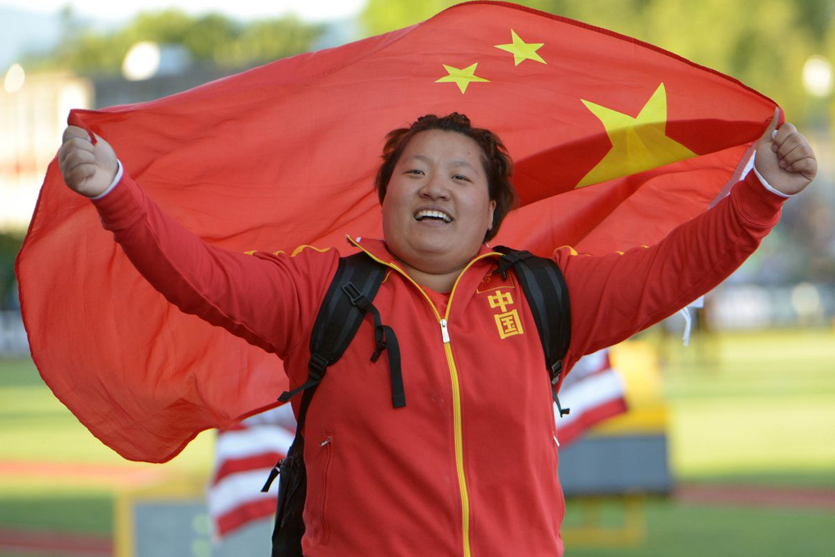 """This is not """"Itchy"""" Xu, but it is a person carrying a Chinese flag."""