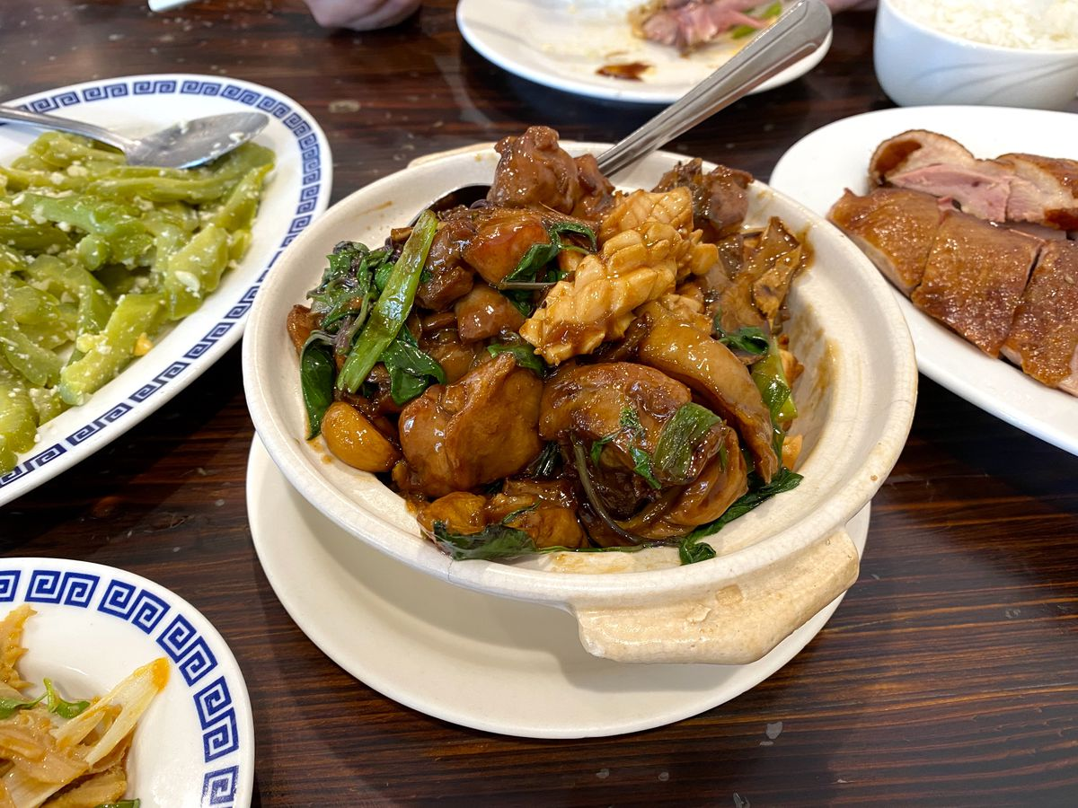 Three cup chicken, intestines, and seafood at Tasty House in San Gabriel.