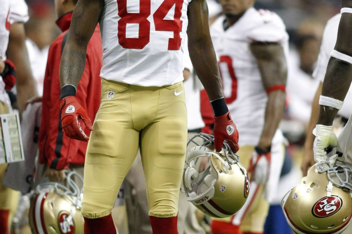 Aug 18, 2012; Houston, TX, USA; San Francisco 49ers wide receiver Randy Moss (84) reacts on the sidelines against the Houston Texans in the first quarter at Reliant Stadium. Mandatory Credit: Brett Davis-US PRESSWIRE