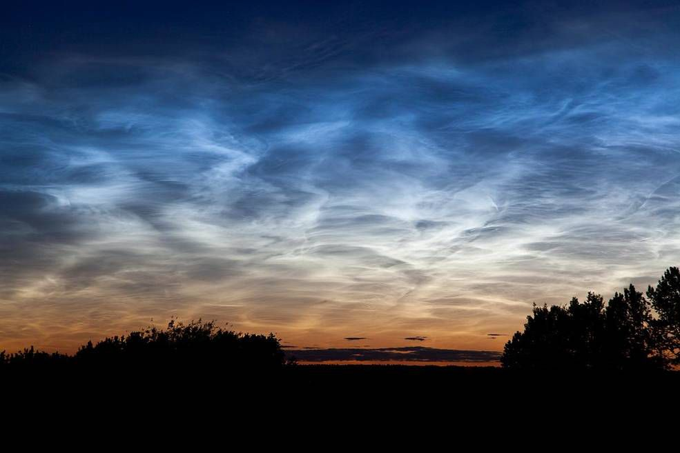Noctilucent clouds appeared in the sky above Edmonton, Alberta, in Canada on July 2, 2011.