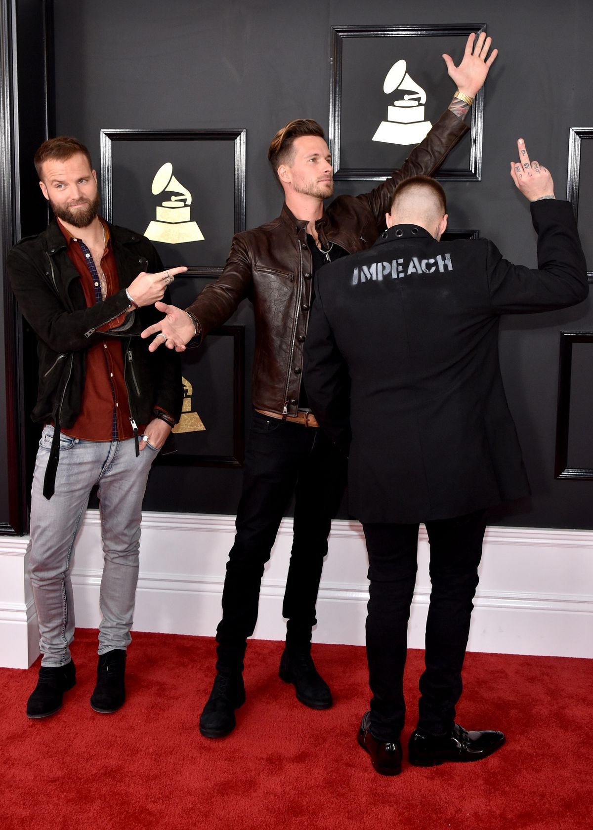 """Highly Suspect's Johnny Stevens in an """"IMPEACH"""" jacket at the 2017 Grammys."""
