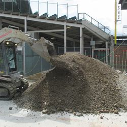 2:44 p.m. Digging in front of Gate R/VIP Gate on Sheffield -