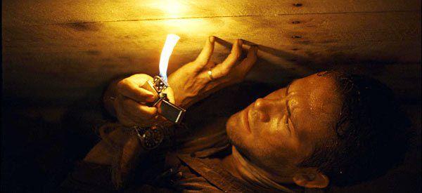 Ryan Reynolds as Paul Conroy in a coffin in 'Buried'