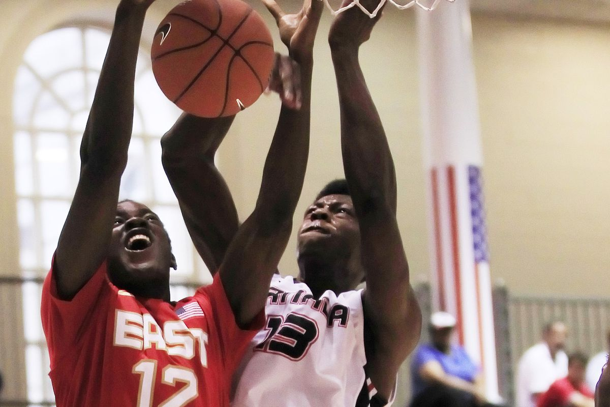 Jabari Craig goes for a block while playing for Team Canada.