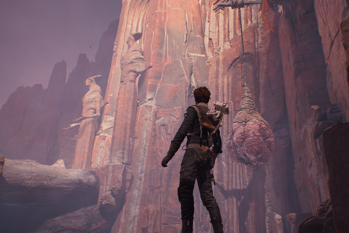 Cal Kestis looks up at Zeffo statues on the planet Dathomir in Star Wars Jedi: Fallen Ordere