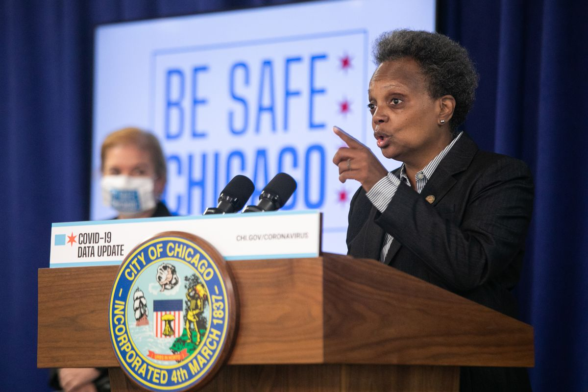 Chicago Mayor Lori Lightfoot at a City Hall press conference in July with Chicago Department of Public Health Commissioner Dr. Allison Arwady.