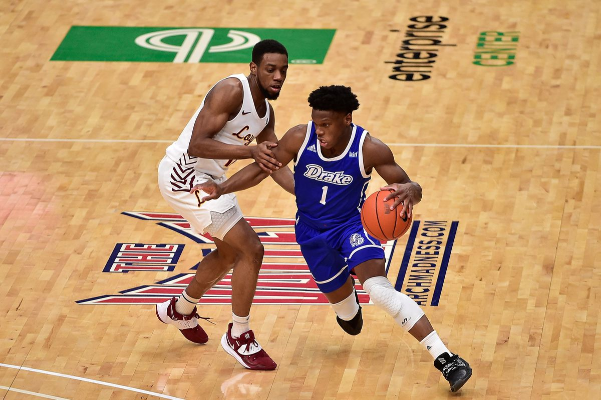 Drake Bulldogs guard Joseph Yesufu drives to the basket as Loyola Ramblers guard Marquise Kennedy defends during the first half in the finals of the Missouri Valley Conference Tournament at Enterprise Center.