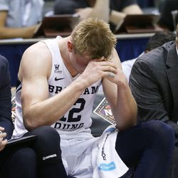 Brigham Young Cougars forward Eric Mika (12) hangs his head as BYU falls to the University of Texas at Arlington play in NIT basketball action at the Marriott Center in Provo, Utah on Wednesday, March 15, 2017.