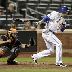 New York Mets' Lucas Duda singles to drive in a run during the eighth inning of the baseball game against the Miami Marlins on Tuesday, April 24, 2012, at Citi Field in New York.