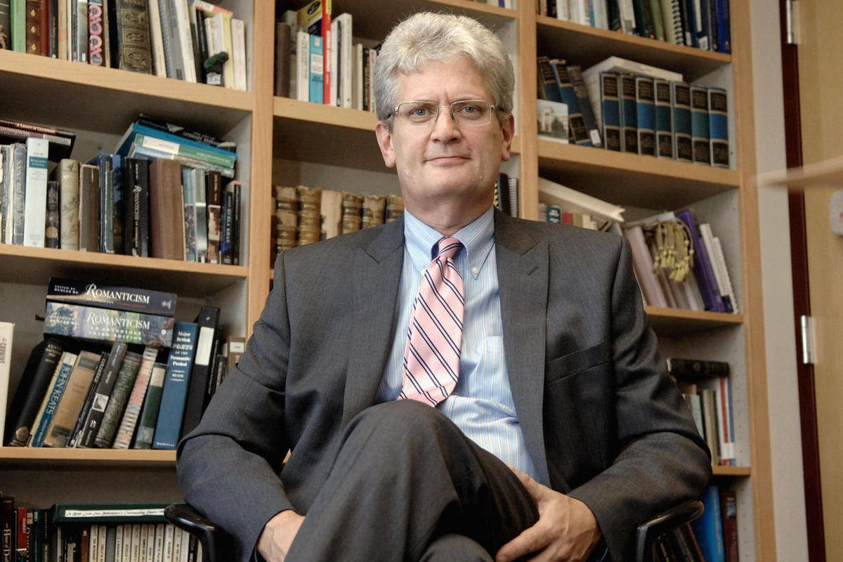 """In this Sept. 14, 2012 photo, Rob Prescott, the chairman of the Bradley University English Department, poses in his office in Peoria, Ill. Prescott recently wrote """"Why to Major In English If You're Not Going To Teach."""""""