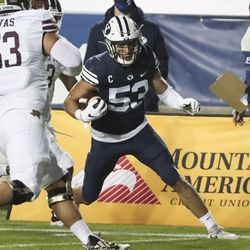 Brigham Young Cougars linebacker Isaiah Kaufusi (53) intercepts the ball and runs for a touchdown in Provo on Saturday, Oct. 24, 2020.