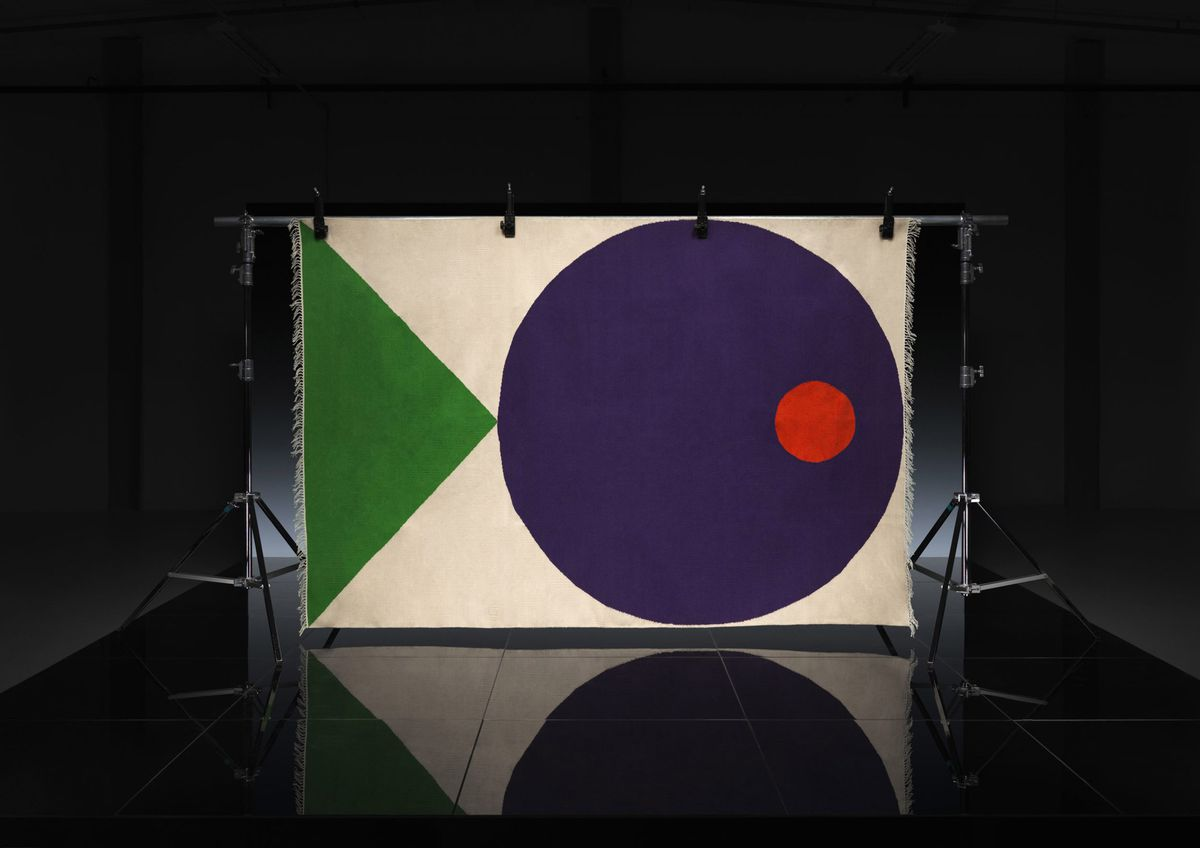 Rug with blue and red circle and green triangle
