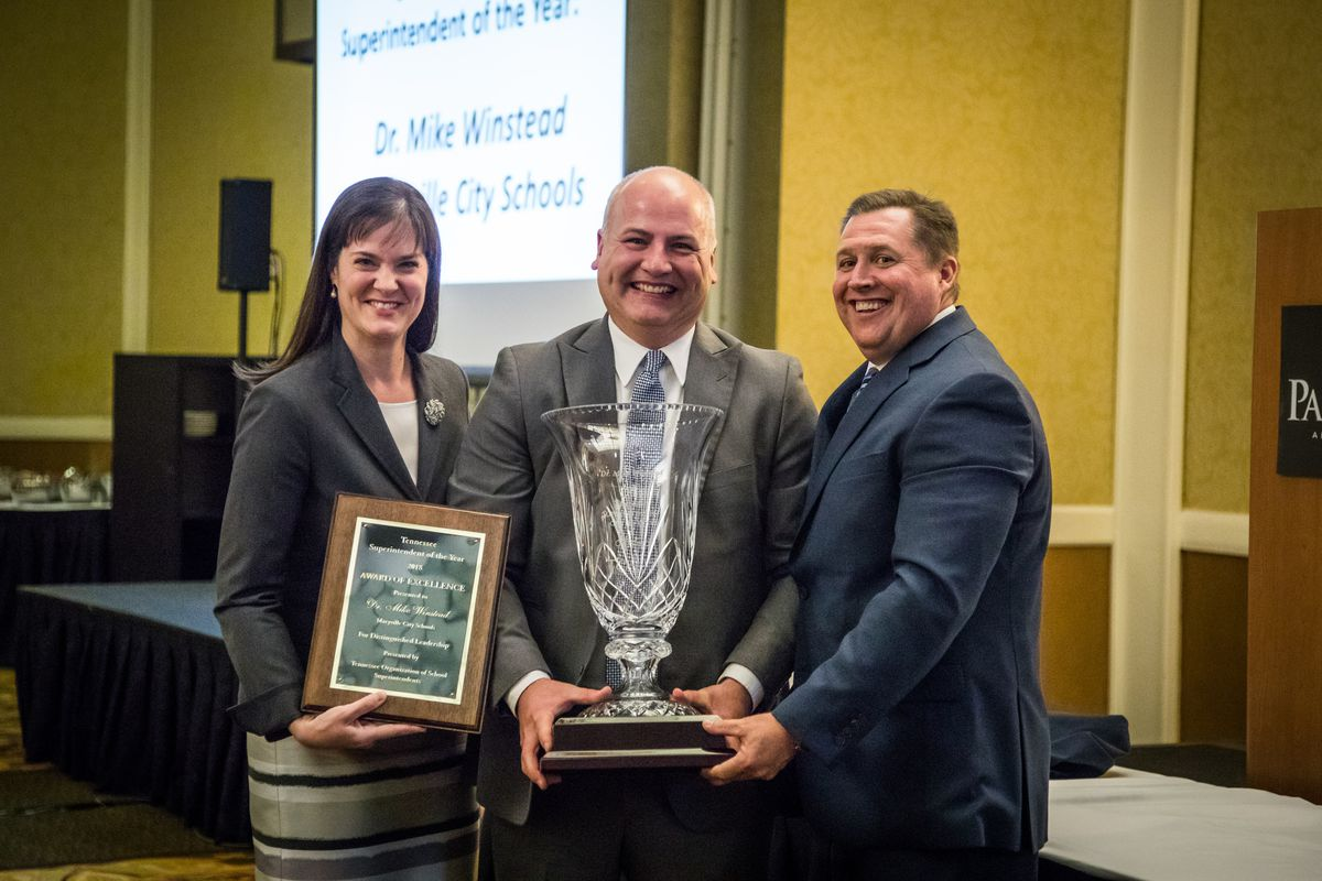 Maryville City Schools Superintendent Mike Winstead (center) receives the 2018 Tennessee Superintendent of the Year award from Education Commissioner Candice McQueen and Dale Lynch, executive director of the Tennessee Organization of School Superintendents.